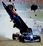 Brasilianeren Luciano Burti på luftetur etter å ha kjørt på Michael Schumacher.