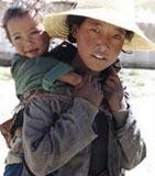 Tibetansk kvinne med barn.