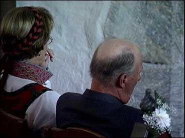 Kongen og dronninga sat på fremste benk.