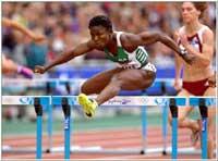 Eks-nigerianske Glory Alozie løper for Spania og er favoritt på 100 meter hekk. (Foto: Allsport)