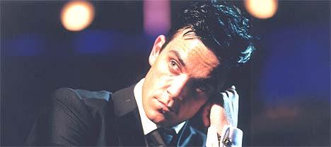 - Jeg vil elske noen. Jeg vil gjerne slå meg til ro nå, sier Robbie Williams. 18. november kommer han med nytt album. Foto: EPA / SCANPIX.