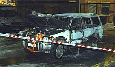 En utbrent bil ble funnet, og politiet setter denne i sammenheng med ranet. (Foto: Scanpix/Knut Fjeldstad)