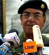 TAPSTALL: Informasjonsminister Mohammed Saeed al-Sahaf satte tallet på døde søndag til 62 (Foto: Reuters).