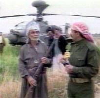En bonde skal ha skutt ned helikopteret med gevær. Bilde fra irakisk fjernsyn.