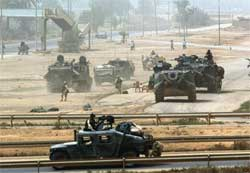 Amerikanske stridsvogner har inntatt Bagdad i dag. Foto: Reuters Goran Tomasevic