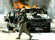 ANGREP: USAs styrker i Irak utsettes for stadige nålestikk-angrep, her i Bagdad 3. juli.