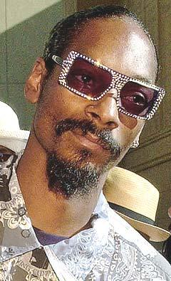 Trondheim får likevel ikke besøk av Snoop Dogg. Foto: AP Photo / Reed Saxon.