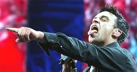 Kan suksessen til Robbie Williams forklares med han både er litt gal og psykotisk? Foto: Uwe Lain, AP Photo