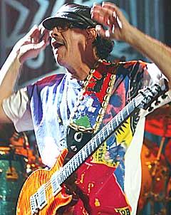 Carlos Santana er på vei til Danmark og Roskilde. Foto: AFP PHOTO.