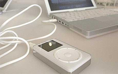 ITunes tilbyr lovlig musikk over internett og planlegger å etablere seg i Europa innen 2004. Foto: Julie Jacobson, AP.