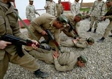 Den internasjonale styrken skal også trene nye irakiske soldater. (Foto: O.Popov, AP)