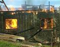 Driftsbygningen på Sæther Gård i Moelv brant ned til grunnen sommeren 2001.