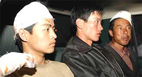 Tre av de løslatte kineserne (foto: AP/Scanpix)