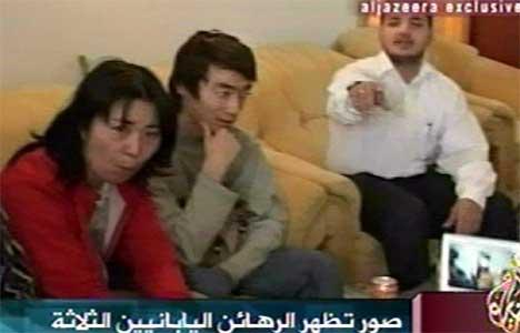 To av de løslate gislene,  Noriaki Imai (t.h.) og Nahoko Takato. (Foto: Scanpix / AFP / Al Jazeera)