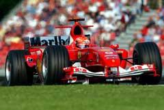 Michael Schumacher tok sin fjerde strake seier på Imolabanen. (Foto: AP/Scanpix)