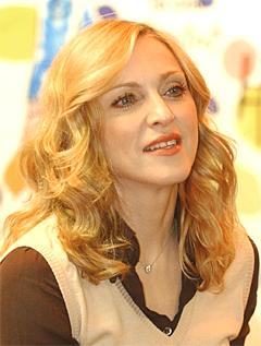 Madonna føler seg dolket i ryggen av Warner Music. Foto: Mary Altaffer, AP Photo.