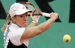 Justine Henin-Hardenne i aksjon mot Tathiana Garbin. (Foto: AFP/Scanpix)