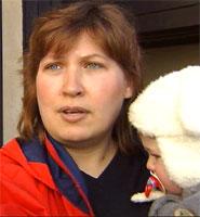 Anne Lize Jensen med Christian på armen.