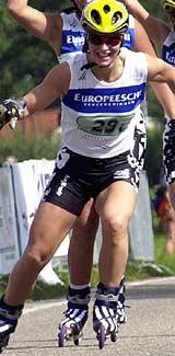 Marit Bjørgen på rulleski i lagtempo-VM 2000 (Foto: Scanpix/Nisse Schmidt)