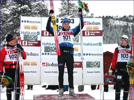 Isfjordingen Håvard Bjerkeli på pallen under ski-NM 2003 på Skaret. Foto: Gunnar Sandvik