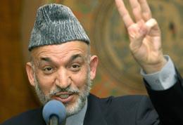 - En stor suksess for det afghanske folket, sier president Hamid Karzai om lørdagens valg. (Foto: E.Dunand, AFP)