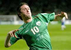 Robbie Keane jubler etter sitt første mål. (Foto: Reuters/Scanpix)