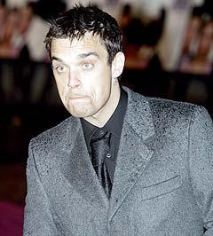 Robbie Williams sier han ble fetere av å ta dop... Foto: Adam Butler, AP Photo.