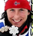 To medaljer til Marit Bjørgen så langt (Foto: AP/Jan Pitman)