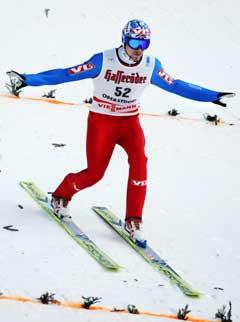 Bjørn Einar Romøren lander på 137 meter i hopp-kvalifiseringen. (Foto: Erlend Aas / SCANPIX)