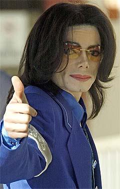 <b>Hvor mye</b> av inntektene etter Live 8 skal du gi til u-land, Michael Jackson? Foto: Damian Dovarganes, AP Photo / Scanpix.