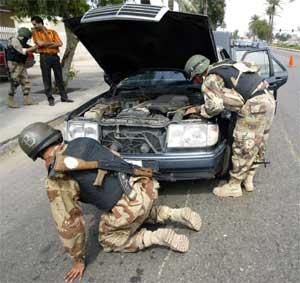 En typisk kontrollpost i Irak. (Foto: Scanpix / AFP)