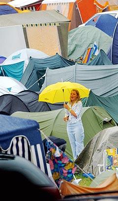 Quartfestivalen frykter at det dårlige været i Kristiansand vil føre til svikt i ølsalget under festivalen. Arkivfoto: Heiko Junge, Scanpix.