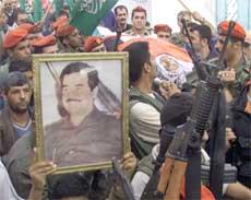 Bush sitt hovedargument var at Saddam Hussein produserte kjernefysiske våpen (Foto: Scanpix/AP/L. Rebours)