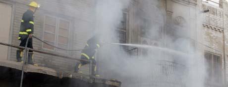 Brann er hverdagskost for Bagdads innbyggere. Bildet er tatt i Bagdad i dag. (Foto: M.Khodur, AFP)