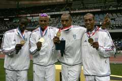 Franskmennene Leslie Djhone, Marc Raquil, Naman Keita and Stephane Diagana ble først i år tildelt gullmedaljene fra VM i 2003. (Foto: AP/Scanpix)
