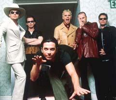 INXS med tidligere vokalist Michael Hutchences. Foto:AP Photo/James Minchin
