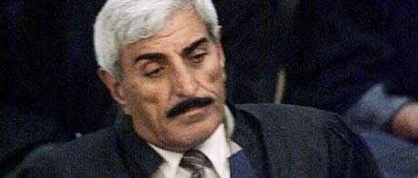 Saadoun Janabi under åpningen av rettssaken mot Saddam Hussein tidligere denne uken. (Foto: Reuters/Scanpix)