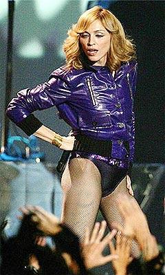 Madonna topper listene med sin nye plate, men drømmer nå om et liv bak kamera. (Foto: Jose Manuel Ribeiro, Reuters/Scanpix)