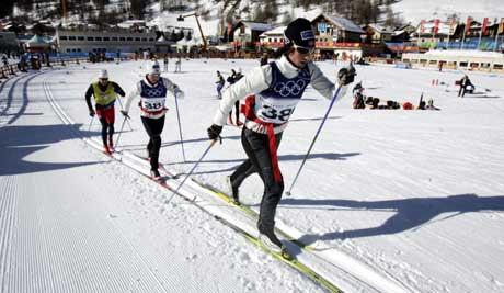 Marit Bjørgen trener i OL-løypene i Pragelato. (Foto: Cornelius Poppe / SCANPIX)