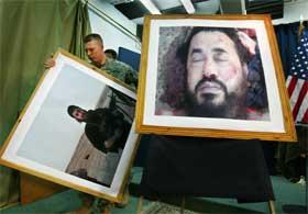 USAs styrker i Irak fant fram en rekke store bilder til pressekonferansen om Zarqawis død. Nå har Al Qaida utnevnt etterfølgeren. (Foto: Khalid Mohammed/AP/Scanpix)