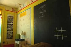 Rommet for den som ikke er skolelei. Foto Carlton Arms Hotel.