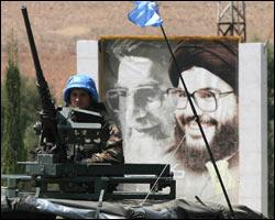 Poster av Hizbollahs leder Sayyed Hassan Nasrallah. Foto: Scanpix/Reuter