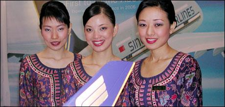 Singapore Airlines crew (AP Photo/Bertrand Combaldieu)