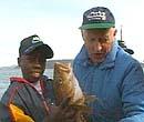 Hassan og Einar på fisketur for fire år siden.